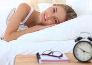 woman in bed can't sleep
