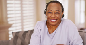 Smiling woman with dental implants in Crown Point