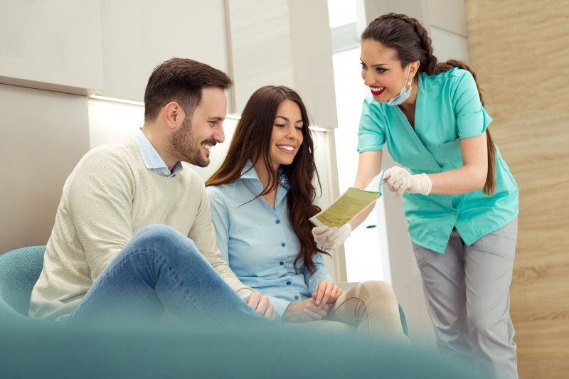 Dentist talking to patients about dental membership plan