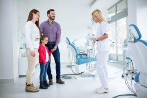 family visiting dentist together in crown point