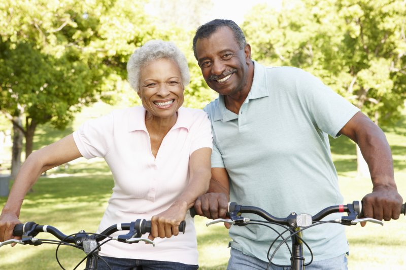 Couple smiling with dental implants