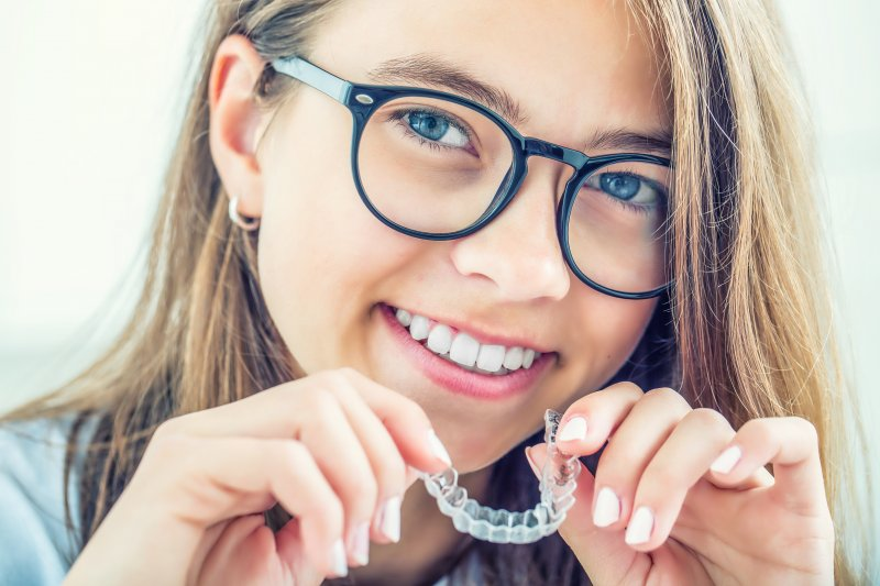 Teen smiling with Invisalign